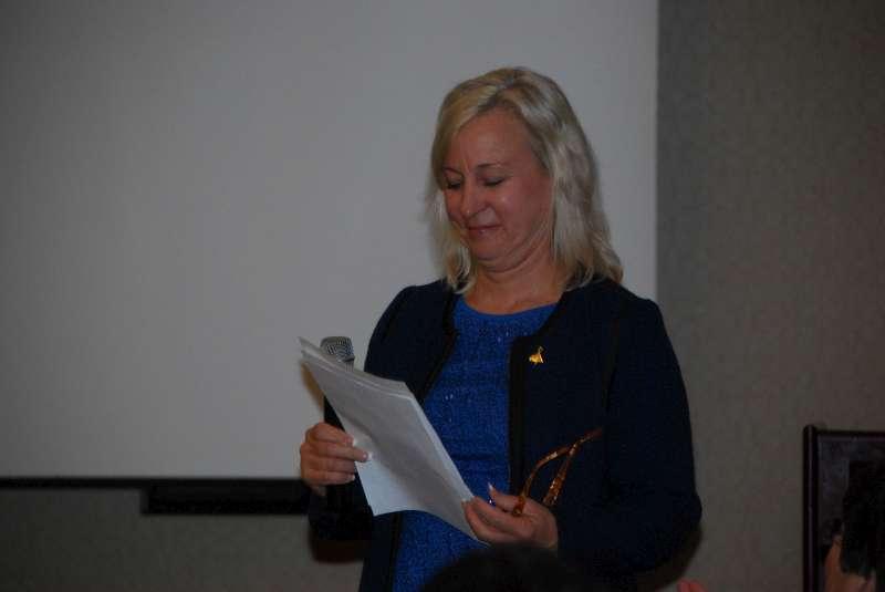 Treasurer Sara Leone smiles about DMD bottom line.docx